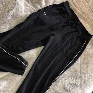 Under ARMOUR joggers.